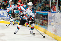 KELOWNA, CANADA, JANUARY 4: Cody Chikie #14 of the Kelowna Rockets skates with the puck as the Spokane Chiefs visit the Kelowna Rockets on January 4, 2012 at Prospera Place in Kelowna, British Columbia, Canada (Photo by Marissa Baecker/Getty Images) *** Local Caption ***