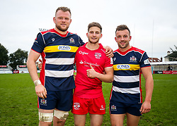 Bristol Rugby academy graduates Joe Joyce of Bristol Rugby, Auguy Slowik of Jersey Reds and Andy Uren of Bristol Rugby pose for a photo after the game  - Rogan/JMP - 28/10/2017 - RUGBY UNION - Stade Santander International - St Peter, Jersey - Jersey Reds v Bristol Rugby - Greene King IPA Championship.