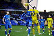 Peterborough United midfielder Siriki Dembele (10) wins this header during the EFL Sky Bet League 1 match between Peterborough United and Oxford United at London Road, Peterborough, England on 8 December 2018.