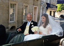 The bride LADY NATASHA RUFUS ISAACS and her father  MARQUESS OF READING at the wedding of Lady Natasha Rufus Isaacs to Rupert Finch held at St.John The Baptist Church, Cirencester, Gloucestershire, UK on 8th June 2013.