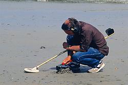 Using Metal Detector On Beach