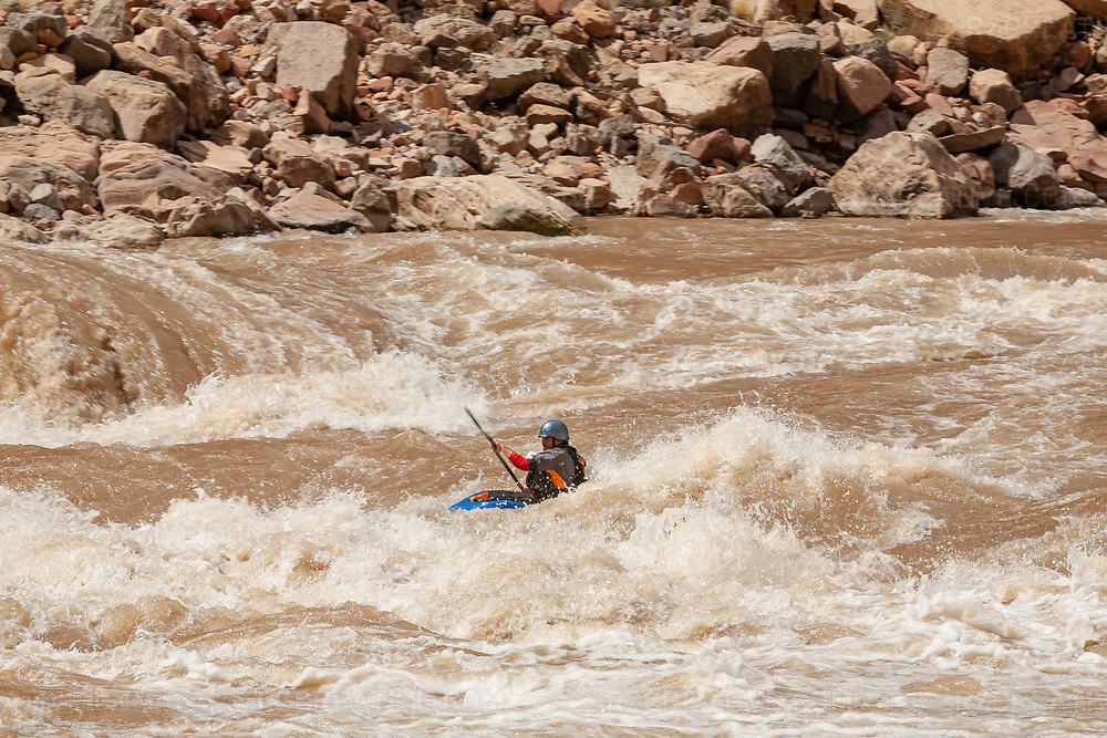 Kayker paddles through a rapid in Cataract Canyon — a 46 mile long canyon of the Colorado River located within Canyonlands National Park and Glen Canyon National Recreation Area in southern Utah. Photo © Robert Zaleski / rzcreative.comPhoto © Robert Zaleski / rzcreative.com<br /> —<br /> To license this image for editorial or commercial use, please contact Robert@rzcreative.com