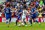 Bournemouth midfielder Ryan Christie (10) is surrounded by Cardiff players during the EFL Sky Bet Championship match between Cardiff City and Bournemouth at the Cardiff City Stadium, Cardiff, Wales on 18 September 2021.