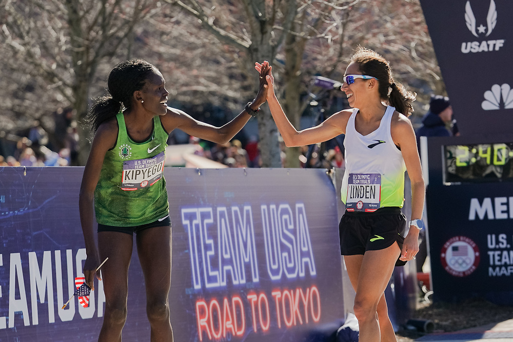 Sally Kipyego (left) celebrates with Des Linden after finishing third and fourth, respectively, in the 2020 U.S. Olympic marathon trials in Atlanta on Saturday, Feb. 20, 2020. Photo by Kevin D. Liles for The New York Times