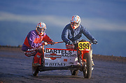 """July 4, 2000, Pikes Peak, Colorado, USA;  Scott Whitney (passenger), and Pete Whitney(driver), set a new course record of 13:59.66 on their 94 Harley-Davidson in the Sidecar Motorcycle division of the 77th running of the Pikes Peak International Hill Climb.  The annual """"Race to the Clouds"""" runs each July 4th on the Pikes Peak Highway near Colorado Springs."""