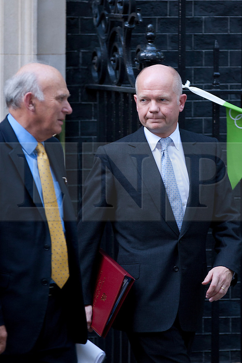 © Licensed to London News Pictures. 05/09/2012. LONDON, UK. William Hague, the Foreign Secretary (R), is seen talking to Vince Cable, the Business Secretary, as they leave Number 10 Downing Street in London today (05/09/12) after attending the first cabinet meeting after a cabinet reshuffle that took place yesterday (04/09/12).  Photo credit: Matt Cetti-Roberts/LNP
