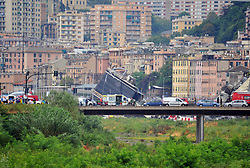 A collapsed bridge over the A10 highway in Genoa, Italy, 14 August 2018. At least 30 people are believed to have died as a large section of the Morandi viaduct upon which the A10 motorway runs collapsed in Genoa on Tuesday.