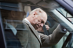 © London News Pictures. 09/06/2012. London, UK. Prince Philip, The Duke of Edinburgh strains as he gets in to a car as he leaves King Edward VII hospital in London on June 09, 2012 in time to spend his 91st birthday at home tomorrow (Sunday). The Duke of Edinburgh had spent five nights in hospital in Central London after falling during the Queens Diamond Jubilee celebrations. Photo credit: Ben Cawthra/LNP