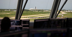 In this photo released by the National Aeronautics and Space Administration (NASA),, A SpaceX Falcon 9 rocket carrying the company's Crew Dragon spacecraft is launched from Launch Complex 39A on NASA's SpaceX Demo-2 mission to the International Space Station with NASA astronauts Robert Behnken and Douglas Hurley onboard, Saturday, May 30, 2020, at NASA's Kennedy Space Center in Florida. The Demo-2 mission is the first launch with astronauts of the SpaceX Crew Dragon spacecraft and Falcon 9 rocket to the International Space Station as part of the agency's Commercial Crew Program. The test flight serves as an end-to-end demonstration of SpaceX's crew transportation system. Behnken and Hurley launched at 3:22 p.m. EDT on Saturday, May 30, from Launch Complex 39A at the Kennedy Space Center. A new era of human spaceflight is set to begin as American astronauts once again launch on an American rocket from American soil to low-Earth orbit for the first time since the conclusion of the Space Shuttle Program in 2011. Mandatory Credit: Joel Kowsky / NASA via CNP. 30 May 2020 Pictured: In this photo released by the National Aeronautics and Space Administration (NASA), Seen through the windows of firing room four of the Launch Control Center, a SpaceX Falcon 9 rocket carrying the company's Crew Dragon spacecraft is launched from Launch Complex 39A on NASA's SpaceX Demo-2 mission to the International Space Station with NASA astronauts Robert Behnken and Douglas Hurley onboard, Saturday, May 30, 2020, at NASA's Kennedy Space Center in Florida. The Demo-2 mission is the first launch with astronauts of the SpaceX Crew Dragon spacecraft and Falcon 9 rocket to the International Space Station as part of the agency's Commercial Crew Program. The test flight serves as an end-to-end demonstration of SpaceX's crew transportation system. Behnken and Hurley launched at 3:22 p.m. EDT on Saturday, May 30, from Launch Complex 39A at the Kennedy Space Center. A new era of human