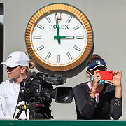 PARIS, FRANCE September 26.  Irina-Camelia Begu of Romania takes pictures as she waits to practice with Simona Halep of Romania (left) as they watch Novak Djokovic of Serbia and Dominic Thiem of Austria during a practice match on Court Philippe-Chatrier in preparation for the 2020 French Open Tennis Tournament at Roland Garros on September 26th 2020 in Paris, France. (Photo by Tim Clayton/Corbis via Getty Images)