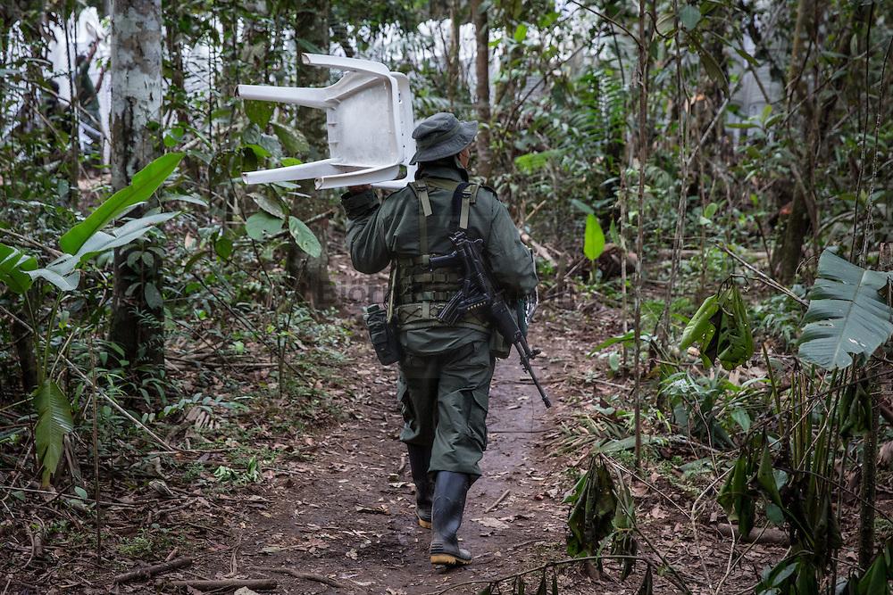 El Diamante, Meta, Colombia - 16.09.2016        <br /> <br /> 10th conference of the marxist FARC-EP in El Diamante, a Guerilla controlled area in the Colombian district Meta. Few days ahead of the peace contract passing after 52 years of war with the Colombian Governement wants the FARC decide on the 7-days long conferce their transformation into a unarmed political organization. <br /> <br /> Zehnte Konferenz der marxistischen FARC-EP in El Diamante, einem von der Guerilla kontrollierten Gebiet im kolumbianischen Region Meta. Wenige Tage vor der geplanten Verabschiedung eines Friedensvertrags nach 52 Jahren Krieg mit der kolumbianischen Regierung will die FARC auf ihrer sieben taegigen Konferenz die Umwandlung in eine unbewaffneten politischen Organisation beschließen. <br />  <br /> Photo: Bjoern Kietzmann