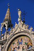 Detailed shot of gilded figures (including a large figure of Archangel Michael), painted murals and weathervanes on top of St. Mark's Basilica (Basilica di San Marco in Venezia), the most famous of the churches of Venice, Italy. The structure is one of the best examples of Byzantine architecture in the world. The building was also nicknamed Chiesa d'Oro ( church of gold ) due to it's lavish design and gilded Byzantine mosaics. The church dates back to 828 A.D and the basilica was consecrated in 1094 A.D...Subject photograph(s) are copyright Edward McCain. All rights are reserved except those specifically granted by Edward McCain in writing prior to publication...McCain Photography.211 S 4th Avenue.Tucson, AZ 85701-2103.(520) 623-1998.mobile: (520) 990-0999.fax: (520) 623-1190.http://www.mccainphoto.com.edward@mccainphoto.com.
