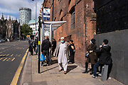 As numbers of Covid-19 cases in Birmingham have dramatically risen in the past week, increased lockdown measures have been announced for Birmingham and other areas of the West Midlands, people wearing face masks waiting at a bus stop just outside the shopping district in the city centre on 12th September 2020 in Birmingham, United Kingdom. With the rule of six also being implemented the Birmingham area has now be escalated to an area of national intervention, with a ban on people socialising with people outside their own household, unless they are from the same support bubble.