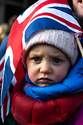 A child covered with the British flag during the Pro Eu protests in London