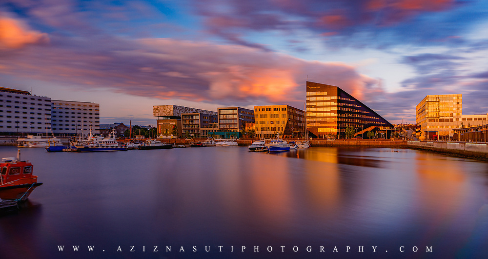 www.aziznasutiphotography.com                                         Picture hasbeen taken at 23:47. Brattøra is an artificial island in the city of Trondheim in Trøndelag county, Norway. The 0.485-square-kilometre island is located at the mouth of the river Nidelva just north of the city centre, west of Nyhavna, and south of Trondheimsfjord.