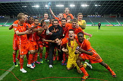 Albert Stuivenberg, head coach of Netherlands celebrates with his players  with a trophy after winning the UEFA European Under-17 Championship Final match between Germany and Netherlands on May 16, 2012 in SRC Stozice, Ljubljana, Slovenia. Netherlands defeated Germany after penalty shots and became European Under-17 Champion 2012. (Photo by Vid Ponikvar / Sportida.com)