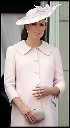 The Duchess of Cambridge feels her bump on the Balcony at Buckingham Palace during Trooping The Colour, London, United Kingdom,<br /> Saturday, 15th June 2013<br /> Picture by Andrew Parsons / i-Images