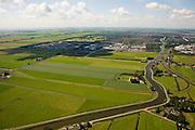 Nederland, Noord-Holland, Purmer, 14-07-2008; ringvaart van de Purmer, Noordelijk kwadrant van de polder is nog ongerept, maar op het tweede plan Stadsuitbreiding: bedrijventerrein de Baanstee (deels in de schaduw), daar achter de woonwijken Purmer-Noord en Purmer-Zuid. .luchtfoto (toeslag); aerial photo (additional fee required); .foto Siebe Swart / photo Siebe Swart