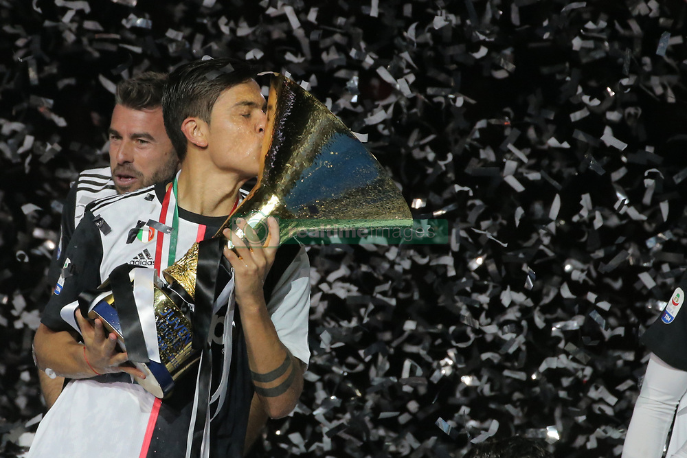 May 19, 2019 - Turin, Turin, Italy - Paulo Dybala #10 of Juventus FC celebrate with the trophy after winning the Serie A Championship at the end of the serie A match between Juventus FC and Atalanta BC at Allianz Stadium on May 19, 2019 in Turin, Italy. (Credit Image: © Giuseppe Cottini/NurPhoto via ZUMA Press)