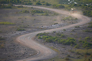 Game drive vehicle on dusty winding road, Amboseli National Park, Kenya, Africa