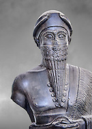 Statue of Puzur-Ishtar Shakkanakku  (military governor or prince c. 2050 BC)) of Mari appointed by the Akkad Kings. According to the inscription below the right hand above the hem of the garment , the sculpture was originally made as a votive gift. The name Puzar-Eshtar, Prince of Mari, is mentioned twice, but the figures headgear is the horned cap of a deity, the statue cannot depict the mortal prince. The clasped hands of the figure and the text make it certain that the statue once belonged to the inventory of a temple, but where the temple stood is not known, despite the mention of Mari in the title of the prince. Like many other monuments, the statue was looted from its original site in Mari and the body was was discovered in the museum of Nebuchadrezzar's palace at Babylon (604-562 BC). This oversized statue is one of the few large preserved sculptures of the Near East. The head was broken from the body in antiquity and both pieces survived separately. The excavated body was taken to the Istanbul Museum and an exchange of casts with the Pergamon Mus The Vorderasiatisches Museum, part of the head from the Pergamon Museum meant that the statue could be reassembled. The Vorderasiatisches Museum, part of the Pergamon Museum, Berlin .<br /> <br /> If you prefer to buy from our ALAMY PHOTO LIBRARY  Collection visit : https://www.alamy.com/portfolio/paul-williams-funkystock/babylon-antiquities.html<br /> <br /> Visit our ANCIENT WORLD PHOTO COLLECTIONS for more photos to download or buy as wall art prints https://funkystock.photoshelter.com/gallery-collection/Ancient-World-Art-Antiquities-Historic-Sites-Pictures-Images-of/C00006u26yqSkDOM