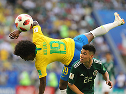July 2, 2018 - Samara, Russia - July 2, 2018, Russia, Samara, FIFA World Cup 2018, 1/8 finals. Football match of Brazil - Mexico at the stadium Samara - Arena. Player of the national team Willian (19), Irving Lozano  (Credit Image: © Russian Look via ZUMA Wire)