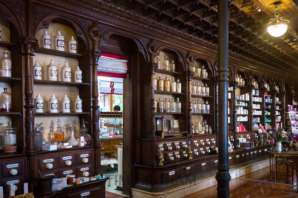 Old medicine bottles pharmacy display in Farmacia Dr A Alonso Nunez pharmacy shop in Calle Ancha, Leon, Castilla y Leon, Spain