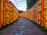 The Kimono Forest at the Keifuku Arashiyama tram station in Kyoto City, Japan was installed at the station's renovation in 2013. It consists of 600 pillars that contain classic kimono fabric designs created by the Kamedatomi textile factory.
