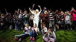 © Licensed to London News Pictures.22/08/15<br /> Castle Howard, North Yorkshire, UK. <br /> <br /> Hundreds of people dance and wave flags as they attend the 25th anniversary of the Castle Howard Proms event near York. The theme of the event this year is a commemoration of the 75th anniversary of the Battle of Britain and the 70th anniversary of VE day and brings an evening of classic musical favourites celebrating Britishness to the lawns of Castle Howard.<br /> <br /> Photo credit : Ian Forsyth/LNP