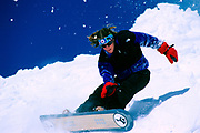 Young male snowboarder in action.