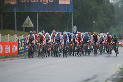 The peloton approach through the rain at the 2020 UEC Road European Championships - Elite Women Road Race, a 109.2 km road race in Plouay, France on August 27, 2020. Photo by Sean Robinson/velofocus.com