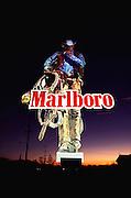 Illuminated Marlboro Man sign at dusk. Rosamond, Edwards Air Force Base, California, USA.