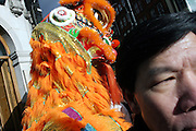 Chinese man walking past a traditional Chinese Dragon in Soho, London, UK, on Sunday, Feb. 13, 2005.  **ITALY OUT**