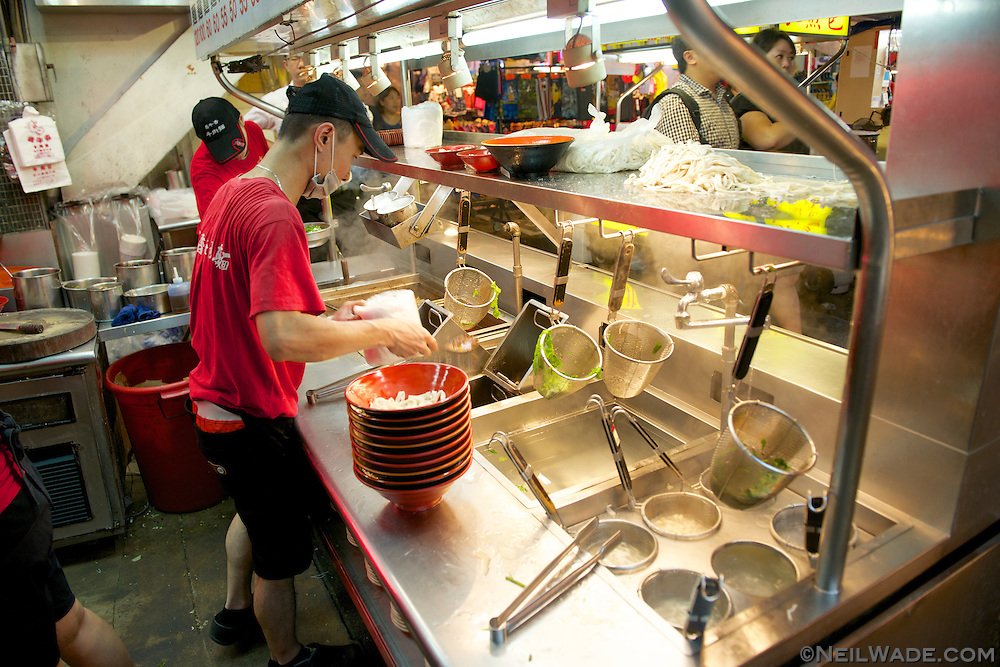 This restaurant cooks their traditional Taiwanese beef noodle soup outside in Raohe Night Market, the serves it on tables inside.