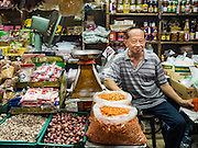 14 DECEMBER 2015 - BANGKOK, THAILAND:  A shop owner in Bang Chak Market. The market closes permanently on Dec 31, 2015. The Bang Chak Market serves the community around Sois 91-97 on Sukhumvit Road in the Bangkok suburbs. About half of the market has been torn down. Bangkok city authorities put up notices in late November that the market would be closed by January 1, 2016 and redevelopment would start shortly after that. Market vendors said condominiums are being built on the land.      PHOTO BY JACK KURTZ
