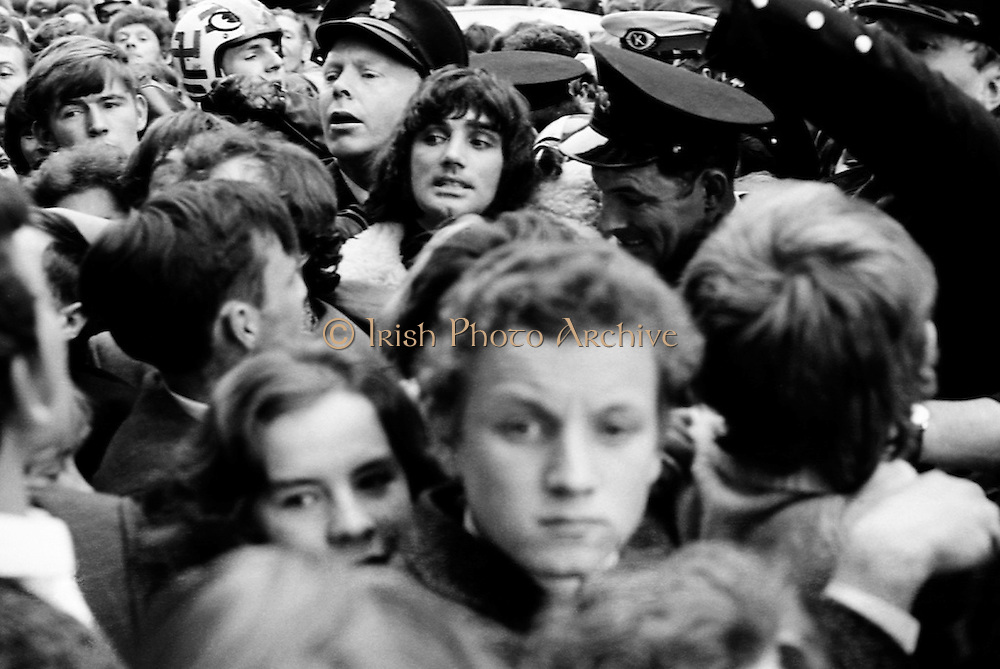 Footballer George Best is mobbed by fans as he arrives to open Penney's Food-hall on Henry Street, Dublin.<br /> 18/08/1970