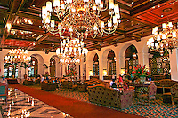 The Manila Hotel is a 570-room five star hotel located in the heart of the Manila Bay area. The Manila Hotel is the oldest premiere hotel in the Philippines, built in 1909 to rival Malacanang Palace.  The main lobby was designed for sitting as well as for making grand entrances.  The floor is Philippine marble, the chandeliers are made of brass, crystal and seashells, the furniture is carved out of Philippine mahogany which is used throughout the hotel.