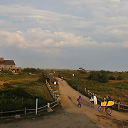 Beach goers head back from Cisco Beach, Nantucket, late in the day. Nantucket Island, Massachusetts, USA. Photo Tim Clayton