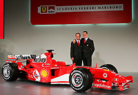 Brazilian Ferrari driver Rubens and German Michael Schumacher pose for photographers during the official presentation of the new F2005 F1 car at the team's headquarters in Maranello.<br /> <br /> <br /> <br /> Rubens Barrichello e Michael Schumacher  durante la presentazione della nuova Ferrari F2005.<br /> <br /> <br /> <br /> Photo Munch / Graffiti