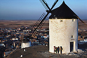Whitewashed windmills on a hilltop above Consuegra, La Mancha, Spain.