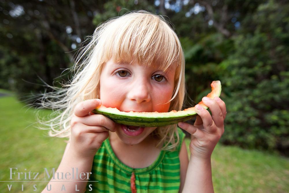 Girl enjoying every last bit of watermelon, Hawaii