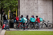 """Following the government decision to reopen Britain, the picture shows """"Deliveroo"""" bicycle units who said they have little to no jobs in the city of Manchester on Wednesday, April 28, 2021. Manchester is part of the UK to lift some of the restrictions designed to stop the spread of Covid-19. (Photo/ Vudi Xhymshiti)"""