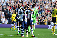 West Brom's Stephane Sessegnon © celebrates with Scott Sinclair after he scores the 1st goal. Barclays Premier league match, West Bromwich Albion v Sunderland at the Hawthorns in West Bromwich, England on Sat 21st Sept 2013. pic by Andrew Orchard, Andrew Orchard sports photography,