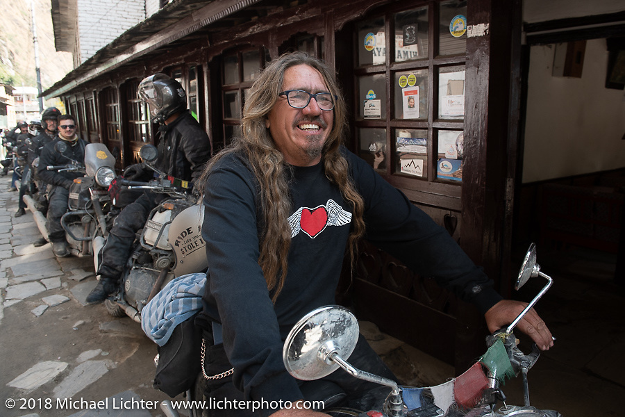 Beanre (Kevin Doebler) on the main street of Tatopani before starting out on Day-7 of our Himalayan Heroes adventure riding from Tatopani to Pokhara, Nepal. Monday, November 12, 2018. Photography ©2018 Michael Lichter.
