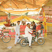 One of the many roadside shop selling Thadel. Thadel is a known a cooling drink. The main ingredient is almonds juice, but it contains many various spices. On the outskirt of Jacobabad.