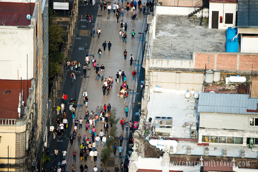 View of pedestrians far below in Mexico City from the 44th floor of the Torre Latinoamericana building.