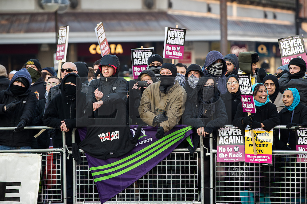 "© Licensed to London News Pictures . 26/11/2016 . Bolton , UK . Anti fascists pictured holding a counter demonstration . Approximately 100 people attend a demonstration against the construction of mosques in Bolton , under the banner "" No More Mosques "" , organised by a coalition of far-right organisations and approximately 150 anti fascists opposing the demonstration , in Victoria Square in Bolton Town Centre . Photo credit : Joel Goodman/LNP"