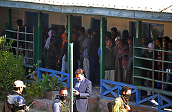 October 7, 2018 - Srinagar, Jammu and Kashmir, India - People stand in queue to cast their votes during first phase of Urban Local Bodies (ULB) elections in Srinagar the summer capital  Indian controlled Kashmir on October 8, 2018. A complete shutdown is being observed across Kashmir valley following the call of shutdown and election bycott by Kashmiri separatist leaders which began on October 8. (Credit Image: © Faisal KhanZUMA Wire)