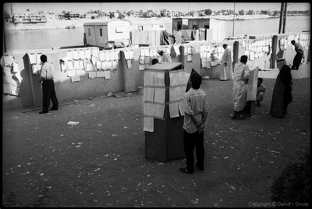 People come from all over Iraq to check lists at the various branches of the Committe of Freed Prisoners in Baghdad, Iraq,which sifts through police files taken from looted ministries, looking for execution and imprisonment records. Human Rights Watch estimates over 200,000 people missing, and the Committee has established offices in many cities in Iraq, sifting the remains of Saddam Hussein's government for clues to their where-abouts.