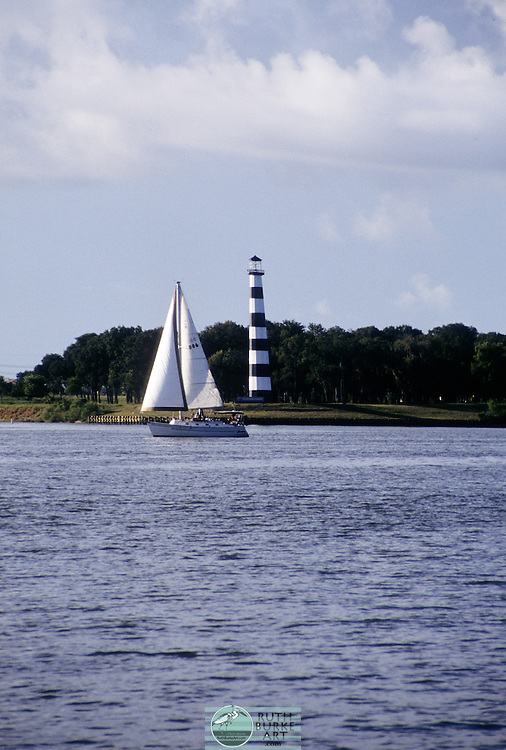 Sailboat With south shore Lighthouse on Clear Lake